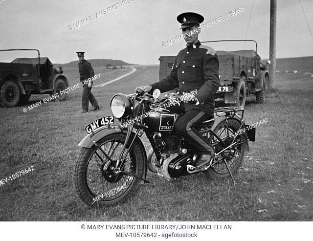 Soldier in dress uniform on a motorbike in a field near Okehampton, Devon