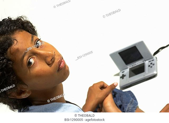 CHILD PLAYING WITH VIDEO GAME<BR>Model