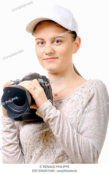 a young photographer woman with white cap