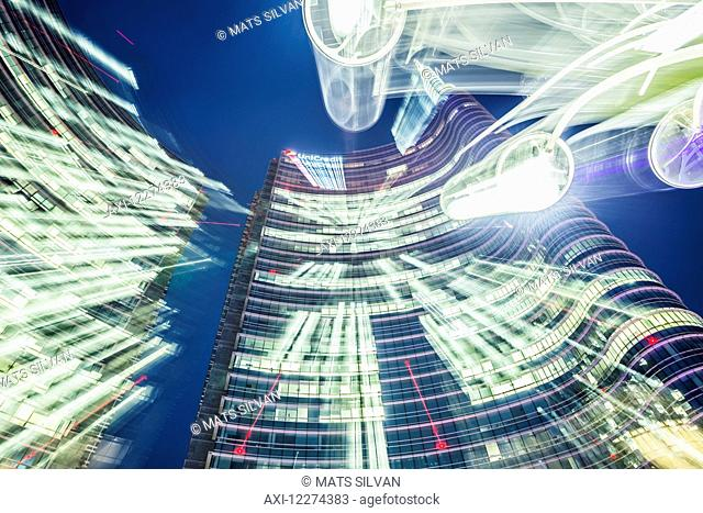 Long exposure of lights and the Unicredit tower in the finance district; Milan, Lombardy, Italy