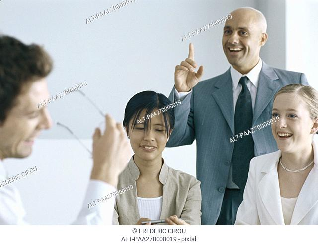 Businesspeople interacting and smiling