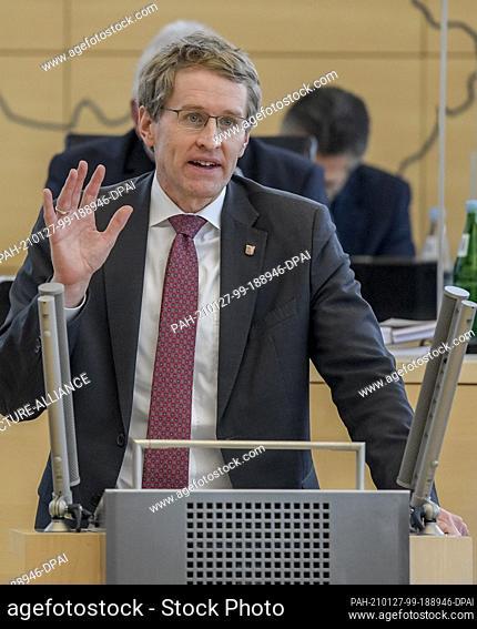 27 January 2021, Schleswig-Holstein, Kiel: Daniel Günther (CDU), Minister President of Schleswig-Holstein, speaks in the plenary chamber of the state parliament