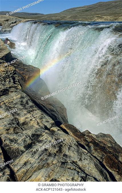 Waterfall and rainbow on river emptying into western end of Wager Bay, Ukkusiksalik National Park, Nunavut, Canada