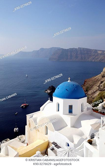 Chruch in Oia seen from above with caldera and neighboring islands, Santorin, Greece, Europe