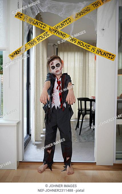 Boy in zombie costume
