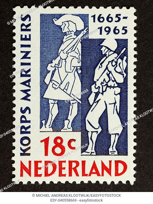 HOLLAND - CIRCA 1960: Stamp printed in the Netherlands shows dutch marines in 1665 and 1965, circa 1960