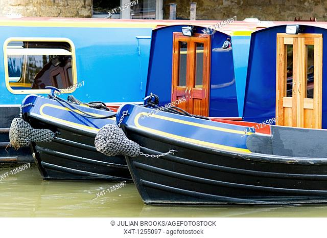 Narrowboats being prepared for hire at Heyford wharf on the Oxford canal