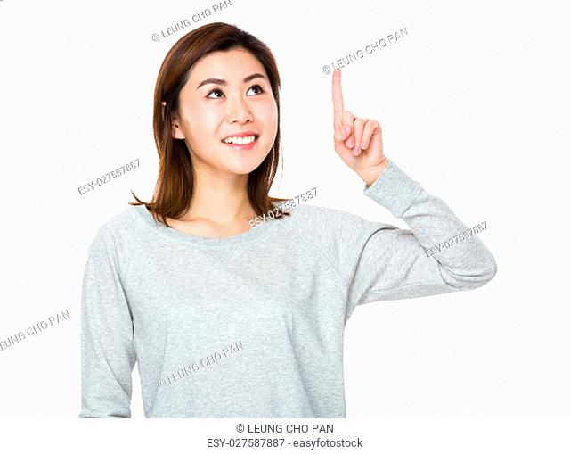 Young Woman looking at the finger point up