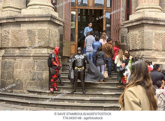 Batman and Spiderman in front of the Central Bank, Dia de Los Muertos, Quito, Ecuador