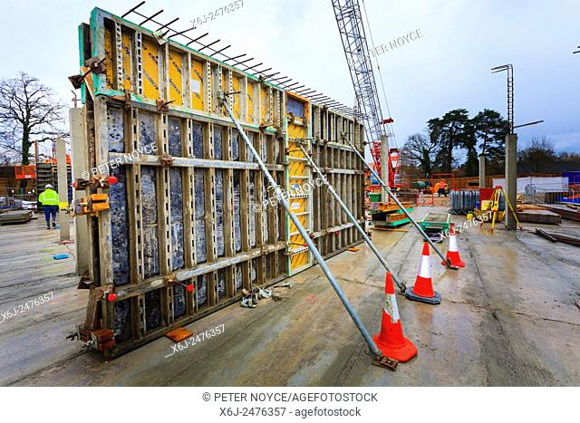 Supported formwork around poured concrete walls on building site