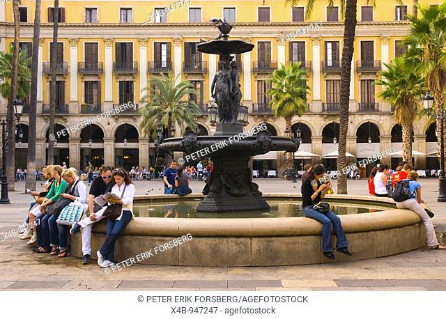 People at the fountain at Placa Reial in central Barcelona Spain Europe