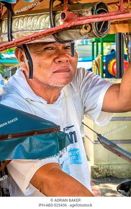 Philippines. Leyte. Baybay. Trishaws known as Pot-Pot riders