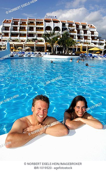 Holidayers in a swimming pool, Parque Santiago, Las Americas, Tenerife, Canary Islands, Spain, Europe