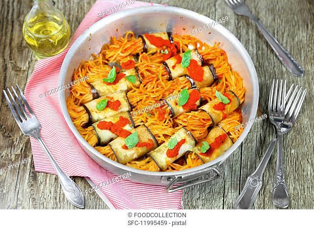 Aubergine rolls with tomato spaghetti