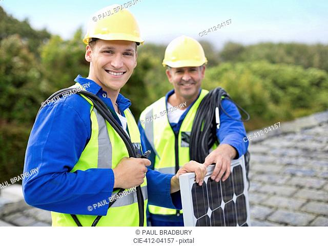 Workers smiling on roof