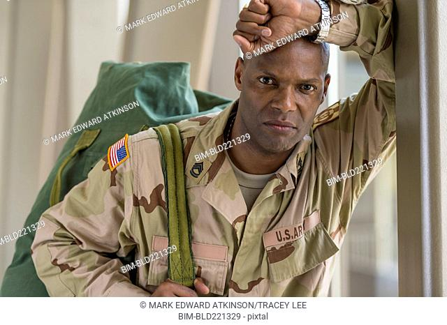 African American soldier carrying duffel bag