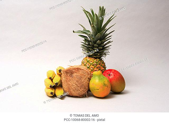 Variety of exotic tropical fruits on a white background