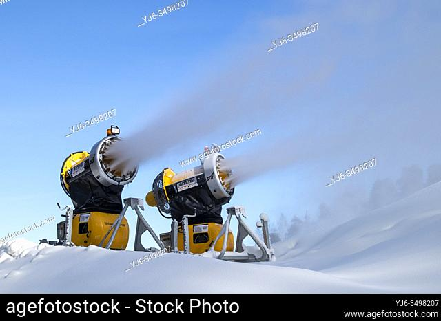 snow cannons spraying artificial snow