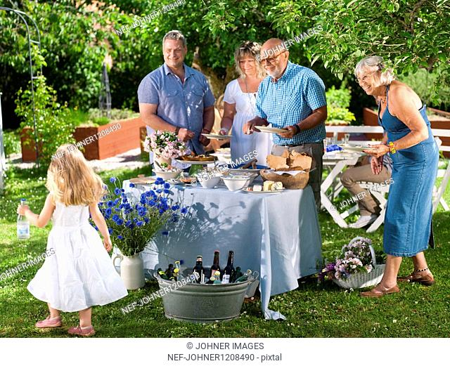 Family having party in garden