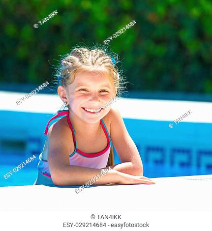 smiling cute little girl swims with a lifeline in the pool 112420f60