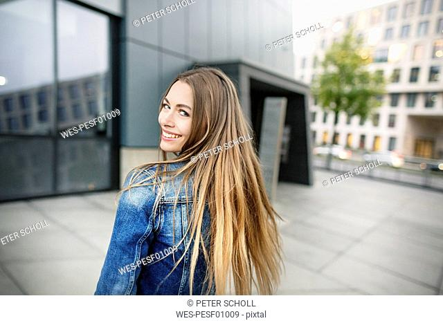 Portrait of happy young woman in the city