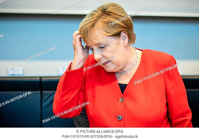 dpatop - 15 October 2019, Berlin: Chancellor Angela Merkel (CDU) will attend the session of the CDU/CSU parliamentary group in the Bundestag