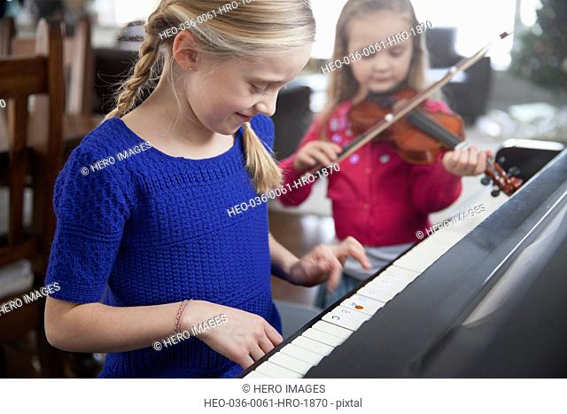 Young sisters practising music together