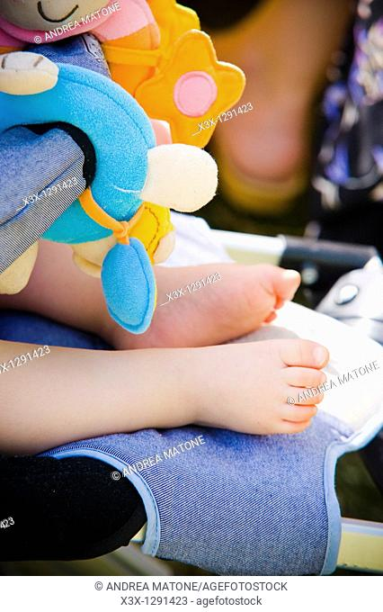 Baby feet in a stroller