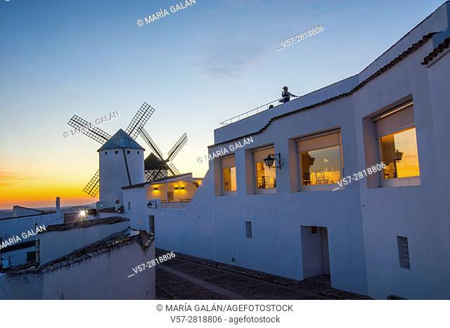 Street and windmills at sunset. Campo de Criptana, Ciudad Real province, Castilla La Mancha, Spain