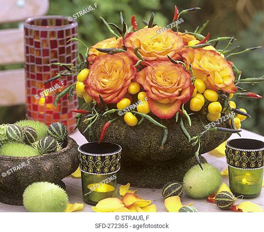 Roses with ornamental peppers and ornamental cucumbers