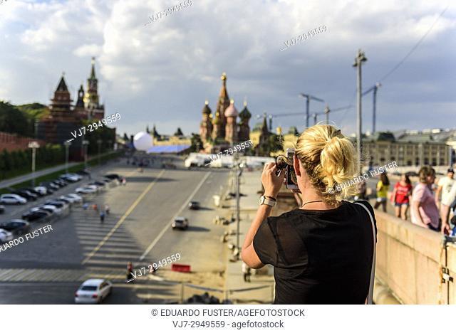 Blondie girl taking photo of Kremlin in Moscow. Russia