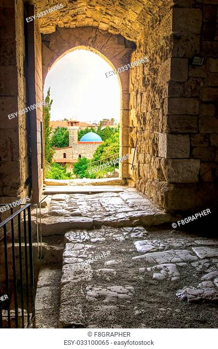 The historic city of Byblos in Lebanon viewed from the gate entrance of the crusaders' castle. A view of the mosque and the path leading to the castle entrance