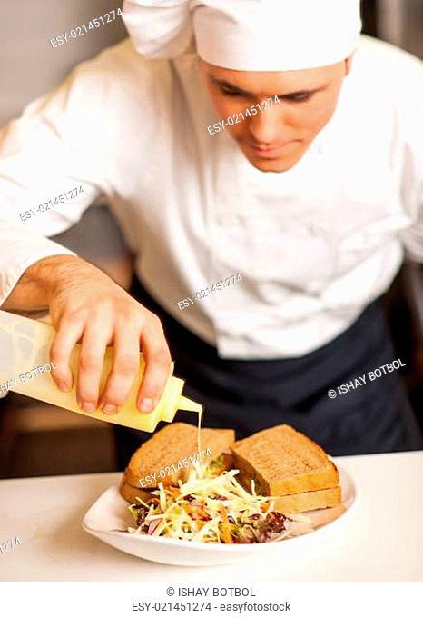 Mayonnaise sauce poured on a vegetable salad