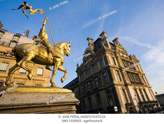 Statue of Joan of Arc, Rue de Rivoli,On background Louvre, Paris, France, Europe
