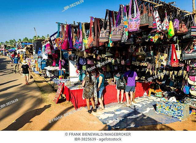 Colourful bags for sale at the weekly flea market, Anjuna, Goa, India