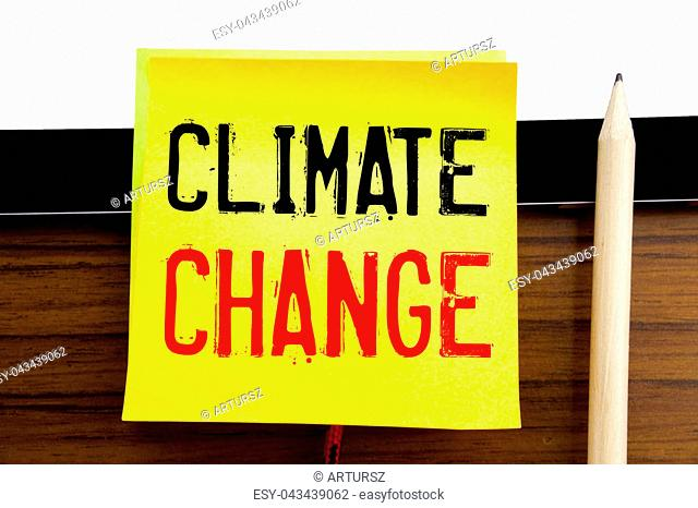 Hand writing text caption inspiration Climate Change. Business concept for Global Planet Warming written on sticky note paper on wooden and tablet background