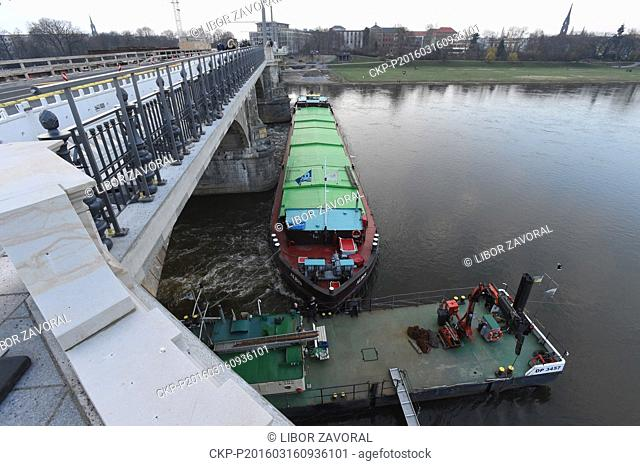 Czech freighter is stuck in front of the pillars of Albert Bridge on the Elbe river in Dresden, Germany, March 16, 2016. A strong current had prevented the...