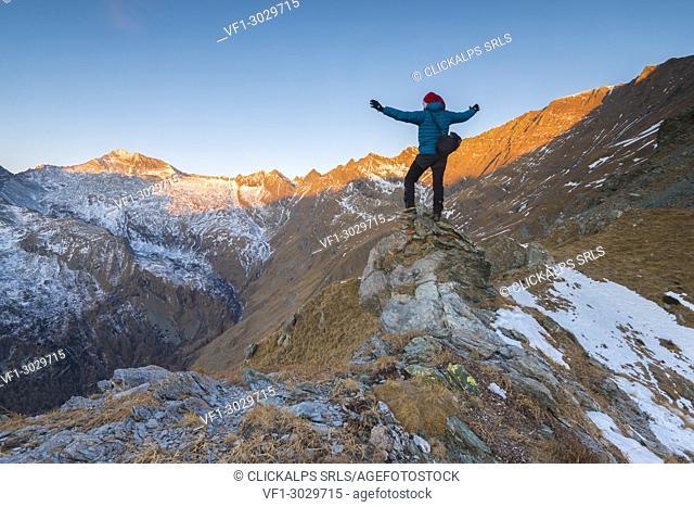 Alpinist seeing the sunrise, Valle Soana, Gran Paradiso National Park, Piedmont, Italy, Italian alps