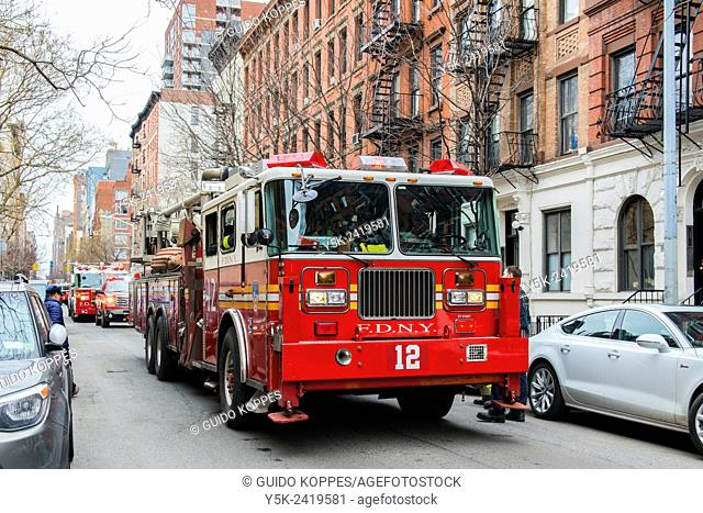 Manhattan, New York City, New York. Firetrucks in front of an apartment building on West 17th Street, just minutes after a stressing 911 call