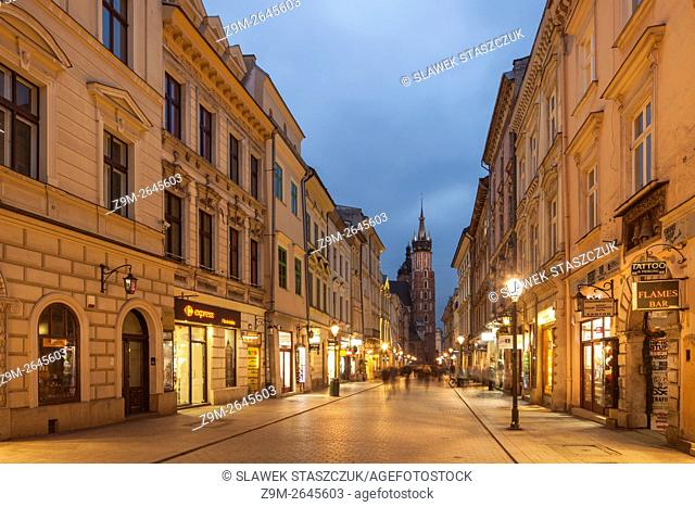 Night falls on Florianska street in Krakow old town, Poland. UNESCO world heritage site