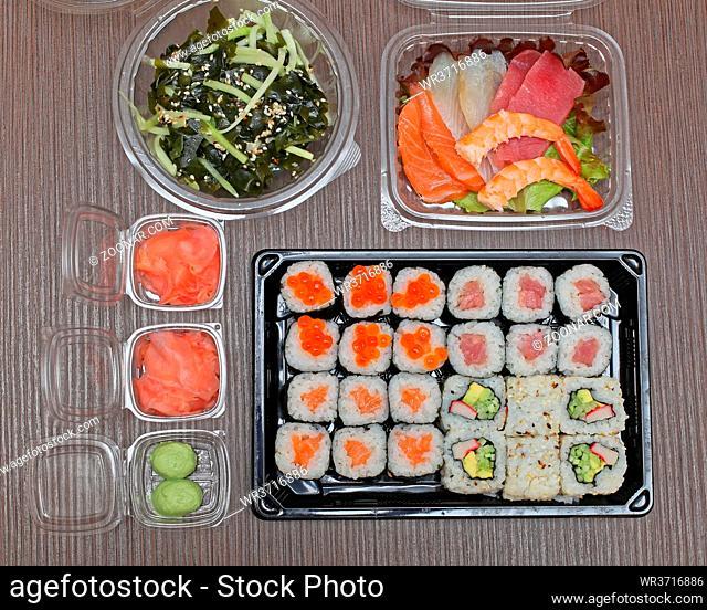 Raw Fish Slices Japanese Sashimi and Sushi Algae Salad