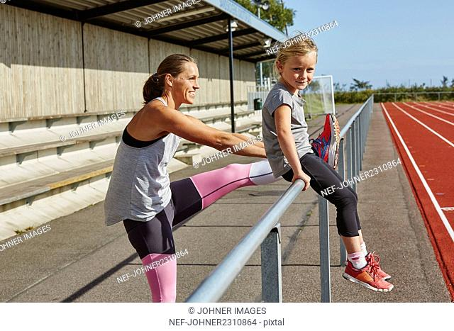 Mother and daughter on stadium