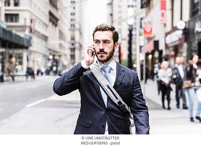 USA, New York City, businessman in Manhattan on cell phone