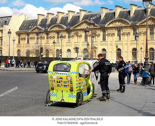 Police officers on inline skates patrol a bicycle rickshaw in the courtyard of the Louvre in Paris, France, 5 April 2015