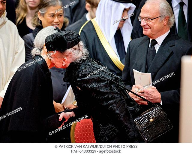 King Carl Gustaf of Sweden, Empress Michiko of Japan (L) and Queen Margrethe of Denmark attend the funeral of Belgian Queen Fabiola at the Cathedral of St