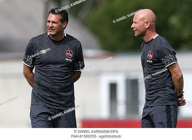 The new head coach of 1. FC Nuernberg, Alois Schwartz (l), standing with co-coach Manuel Kloekler (r) at the start of training at Max-Morlock-Platz in Nuremberg