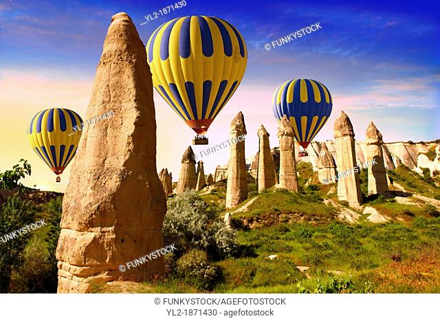 Hot Air Baloons over the Love Valley at sunrise , Cappadocia Turkey