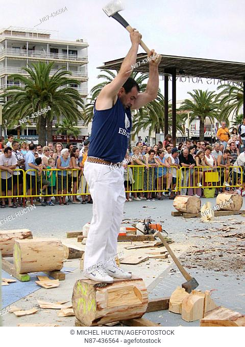 'Aizkolari' man cutting log with an axe, demonstration of 'aizkora' (traditional Basque sport). Salou, Tarragona province. Catalonia, Spain
