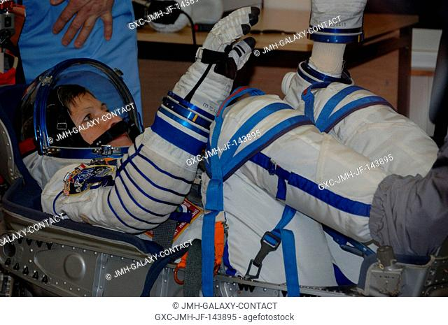 In the Integration Facility at the Baikonur Cosmodrome in Kazakhstan, Expedition 50-51 crew member Peggy Whitson of NASA undergoes a pressure test of her Sokol...