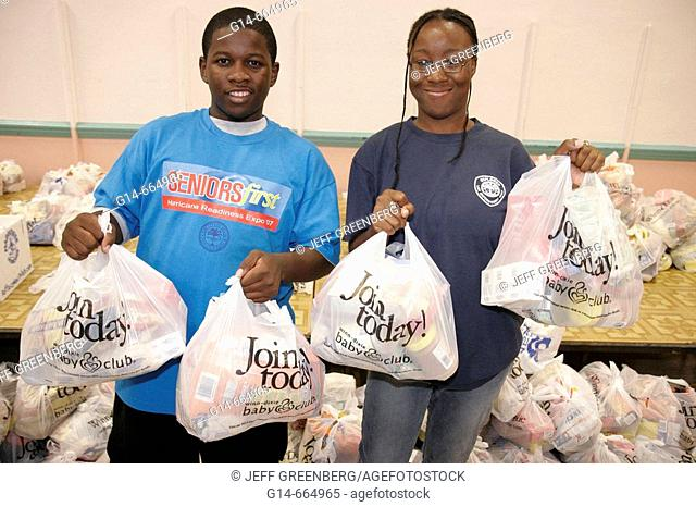 Florida, Miami, Mahi Auditorium, Seniors First Hurricane Readiness Expo, Black teen volunteers, donated food bags